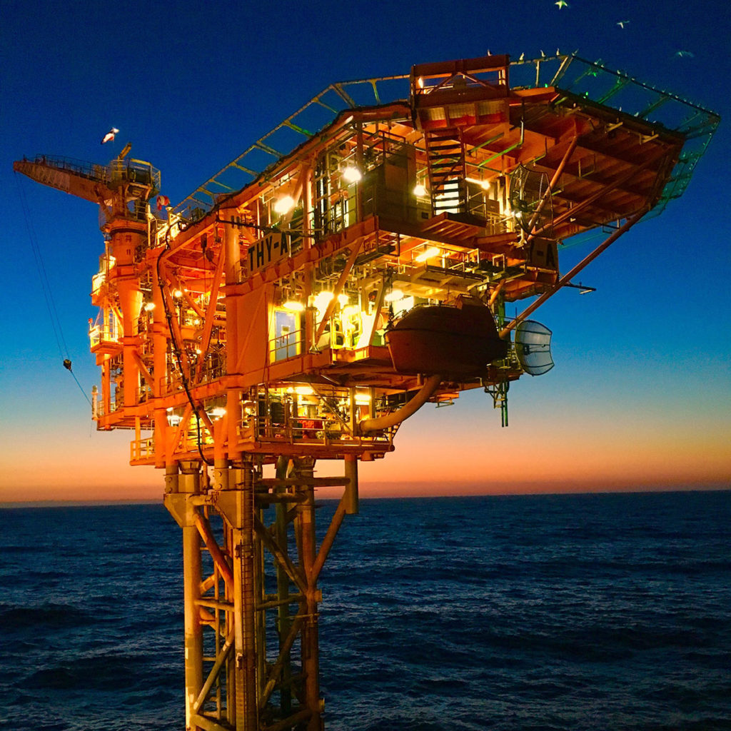 Image of Thylacine-offshore platform, Otway, in the early morning with calm sea and magnificent crimson sunrise in background